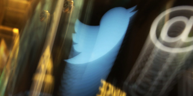 FILE - In this Wednesday, Nov. 6, 2013, file photo, the Twitter logo appears on an updated phone post on the floor of the New York Stock Exchange. Twitter reports financial results Thursday, Oct. 27, 2016. (AP Photo/Richard Drew, File)