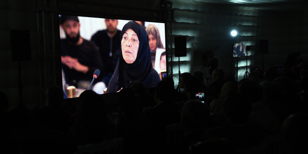 A picture taken on November 17, 2016, in Tunis shows relatives of abuse victims watching a live broadcast of Ourida Kadoussi, the mother of a protester shot by security forces in January 2011 during the uprising that toppled longtime dictator Zine El Abidine Ben Ali, as she delivers her testimonial before the The Truth and Dignity Commission (IVD). Victims of murder, rape and torture under successive dictatorships started testifying on live television Thursday as Tunisia -- in a rare move for the Arab world -- tries to deal with decades of abuse.  The Truth and Dignity Commission (IVD) has tracked human rights violations committed between July 1955, a year before Tunisia gained its independence from France, and December 2013 when the fact-finding body was established. / AFP / FETHI BELAID        (Photo credit should read FETHI BELAID/AFP/Getty Images)