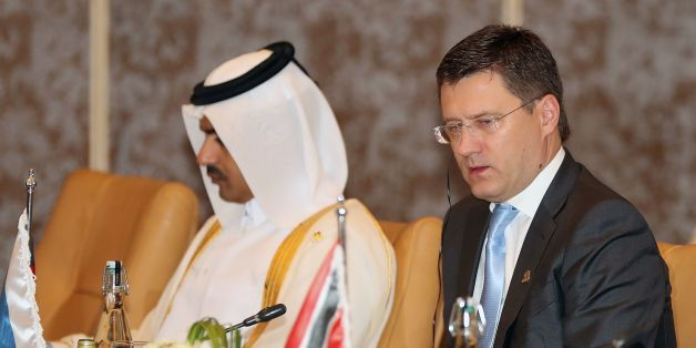 Russian Energy Minister Alexander Novak (R) attends the 18th Ministerial Meeting of the Gas Exporting Countries Forum (GECF) in the capital Doha on November 17, 2016. / AFP / KARIM JAAFAR        (Photo credit should read KARIM JAAFAR/AFP/Getty Images)