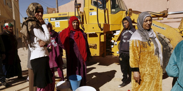 Women queue to fill their buckets with water from a portable tank at the impoverished Karma neighborhood of Kasserine, where young people have been demonstrating for jobs since last week, January 27, 2016. REUTERS/Zohra Bensemra