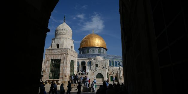 Palestinians walk past the Dome of Rock at the Al-Aqsa Mosque compound after the Friday prayer in Jerusalem's Old City on November 11, 2016. / AFP / AHMAD GHARABLI        (Photo credit should read AHMAD GHARABLI/AFP/Getty Images)