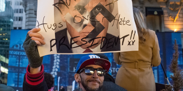 MANHATTAN, NEW YORK, NY, UNITED STATES - 2016/11/12: At the conclusion of a mass rally near Trump Tower, a demonstrator displays a sign. Following a rally on the fourth day after the U.S. Presidential election, several hundred demonstrators took to the streets of midtown Manhattan, staging an unauthorized march through traffic, eventually ending near West 57th Street and Seventh Avenue after passing through Times Square. (Photo by Albin Lohr-Jones/Pacific Press/LightRocket via Getty Images)