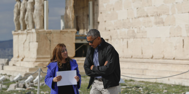 US President Barack Obama tours Acropolis with Dr. Eleni Banou, left, Director, Ephorate of Antiquities for Athens, Ministry of Culture, Wednesday, Nov. 16, 2016 in Athens. (AP Photo/Pablo Martinez Monsivais)