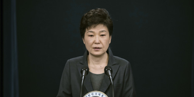 FILE - In this Friday, Nov. 4, 2016, file photo, South Korean President Park Geun-hye speaks during an address to the nation, at the presidential Blue House in Seoul, South Korea. In only a few days, South Korea's biggest scandal in years has done what six decades of diplomacy and bloodshed couldn't, uniting the rival Koreas, at least in one area: indignation against South Korea's leader. North Korean propaganda regularly attacks South Korean President Park Geun-hye. Many South Koreans now seem to be reaching Pyongyang levels of fury over an investigation into whether Park allowed a longtime confidante to manipulate her administration from the shadows. (Ed Jones/Pool Photo via AP, File)