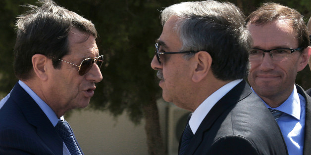 Cypriot President Nicos Anastasiades, left, breakaway Turkish Cypriot leader Mustafa Akinci, right, talks as the UN Special Advisor of the Secretary-General Espen Barth Eide, right, looks on as they leave their talks aimed at reunifying the ethnically divided island, at the disused Nicosia airport inside a United Nations controlled buffer zone on Wednesday, Sept. 14, 2016. The rival leaders of ethnically split Cyprus say they will meet with the U.N. Chief later this month to take stock of ongoin