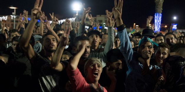 Protesters shout slogans in the northern Moroccan city of Al Hoceima on October 30, 2016, following the death of fishmonger Mouhcine Fikri, who was crushed to death on October 28 in a rubbish truck in Al Hoceima, as he reportedly tried to protest against a municipal worker seizing and destroying his wares.  Thousands of Moroccans on October 30 attended the funeral of the fishmonger whose gruesome death in a rubbish truck crusher has caused outrage across the North African country. An image of hi