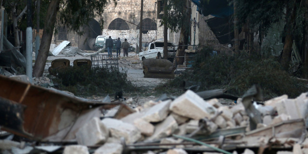 People walk near rubble of damaged buildings, in the rebel-held besieged area of Aleppo, Syria November 19, 2016. REUTERS/Abdalrhman Ismail