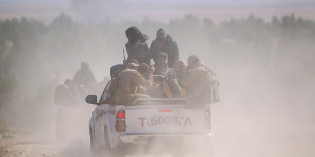 Democratic Forces of Syria fighters ride a pick-up truck near al-Shadadi town, Hasaka countryside Syria February 18, 2016. REUTERS/Rodi Said       TPX IMAGES OF THE DAY