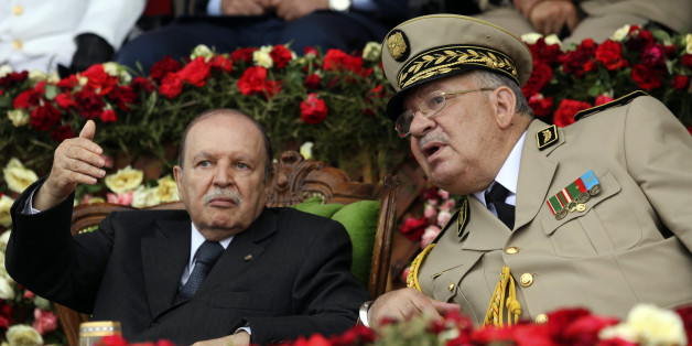 Algeria's President and head of the Armed Forces Abdelaziz Bouteflika (L) gestures while talking with Army Chief of Staff General Ahmed Gaid Salah during a graduation ceremony of the 40th class of the trainee army officers at a Military Academy in Cherchell 90 km west of Algiers June 27, 2012. REUTERS/Ramzi Boudina (ALGERIA - Tags: MILITARY POLITICS)