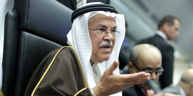 Ali Bin Ibrahim al-Naimi, Saudi Arabia's petroleum and mineral resources minister, gestures as he speaks to journalists ahead of the 168th Organization of Petroleum Exporting Countries (OPEC) meeting in Vienna, Austria, on Friday, Dec. 4, 2015. Oil headed for its fourth decline in five weeks as the Organization of Petroleum Exporting Countries looked set to leave its production ceiling unchanged at a meeting in Vienna on Friday. Photographer: Lisi Niesner/Bloomberg via Getty Images