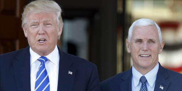 President-elect Donald Trump and Vice President-elect Mike Pence pause for photographs as they arrive at the Trump National Golf Club Bedminster clubhouse in Bedminster, N.J., Saturday, Nov. 19, 2016. (AP Photo/Carolyn Kaster)