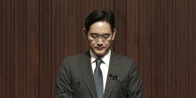 Lee Jae-yong, the heir of the Samsung business empire, reacts during a press conference at the company's headquarters in Seoul, South Korea, Tuesday, June 23, 2015. Lee bowed deep in apology Tuesday as criticism mounted over a Samsung hospital's role in spreading Middle East respiratory syndrome in South Korea. (AP Photo/Ahn Young-joon)