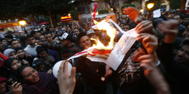 """Tunisians celebrate the first year anniversary of the revolution  as they burn pictures of Tunisia's ousted president Zine al-Abidine Ben Ali at Bourguiba Avenue in Tunis January 14, 2012. Tunisians on Saturday marked the first anniversary of the revolution that started the """"Arab Spring"""" with celebrations that were true to the spirit of the revolt: raucous, unscripted, and driven by the energy of ordinary people. Thousands of people flooded into Bourguiba Avenue in the centre of the capital, the same spot where demonstrators massed exactly one year ago, forcing autocratic leader Zine al-Abidine Ben Ali to accept his rule was over and flee the country.  REUTERS/Anis Mili (TUNISIAANNIVERSARY - Tags: POLITICS CIVIL UNREST)"""