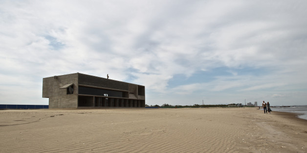 QINHUANGDAO, CHINA - MAY 12:  (CHINA OUT) General view of a public benefit library located at the north part of International Sandboarding Center in Beidaihe's New District on May 13, 2015 in Qinhuangdao, Hebei province of China. A free library opened on May 1 (Workers' Day) at the seaside of Beidaihe New District and has attracted visitors to read here thanks to its original designs and quiet atmosphere. The library is made from concrete and wood and deeply 'rooted' in coastal beach. The boundless sea outside the library and the quiet space in the library make it China's 'Loneliest' library.  (Photo by VCG/VCG via Getty Images)