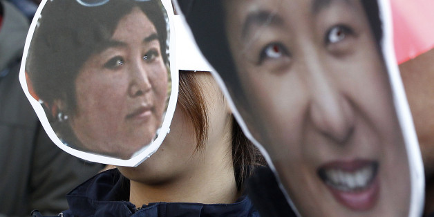 South Korean protesters wearing masks of South Korean President Park Geun-hye, right, and Choi Soon-sil, who is at the center of a political scandal, attend a rally calling for Park to step down in downtown Seoul, South Korea, Wednesday, Nov. 2, 2016. South Korea's embattled president has replaced her prime minister and two other top officials in a bid to restore public confidence amid a political scandal involving her longtime friend. (AP Photo/Ahn Young-joon)