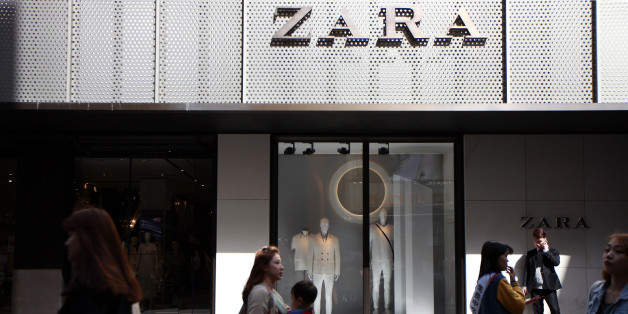 Pedestrians and shoppers walk past a Zara fashion store, operated by Inditex SA, in the Myeongdong shopping district of Seoul, South Korea, on Friday, April 17, 2015. South Korea is scheduled to release gross domestic product (GDP) figures on April 23. Photographer: Woohae Cho/Bloomberg via Getty Images
