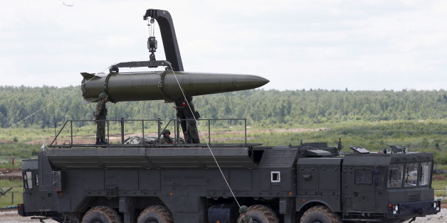 Russian servicemen equip an Iskander tactical missile system at the Army-2015 international military-technical forum in Kubinka, outside Moscow, Russia, June 17, 2015. REUTERS/Sergei Karpukhin