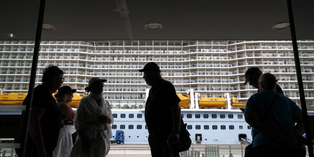 "Tourists enter a passenger terminal, after their arrival with the ""Ovation of the Seas"" cruise ship at the port of Piraeus, near Athens, on Sunday, May 15, 2016. Greece expects a significant increase in the number of tourists who will be visiting the country in 2016, according to the Greek Ministry of Tourism. (AP Photo/Yorgos Karahalis)"