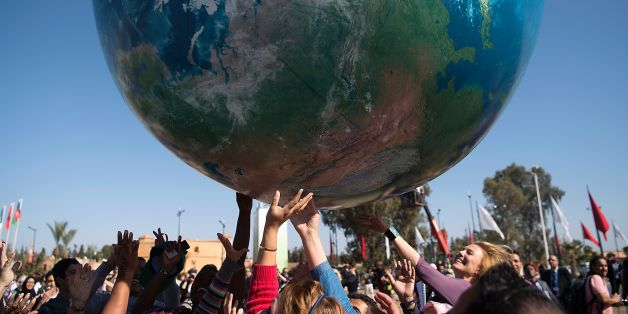 Members of International delegations play with a giant air globe ball outside the COP22 climate conference on November 18, 2016, in Marrakesh. / AFP / FADEL SENNA        (Photo credit should read FADEL SENNA/AFP/Getty Images)