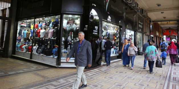 People walk past a clothes shop in Tunis, Tunisia, April 25, 2016.   REUTERS/Zoubeir Souissi