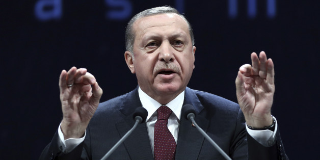 Turkey's President addresses police officers in Ankara, Turkey, Tuesday, Nov. 22, 2016. Turkey's government on Tuesday dismissed a further 15,000 people from the military, police and the civil service as part of an ongoing investigation into the failed military coup in July. Erdogan said Tuesday that the civil service was still not entirely purged of U.S.-based Muslim cleric Fethullah Gulen's followers and vowed take all measures necessary to eradicate the group. (Murat Cetinmuhurdar, Presidential Press Service, Pool photo via AP)