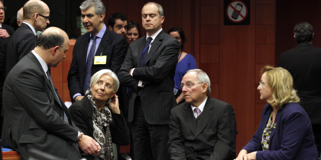(L-R) France's Finance Minister Pierre Moscovici, International Monetary Fund (IMF) managing director Christine Lagarde, Germany's Finance Minister Wolfgang Schauble and Austria's Finance Minister Maria Fekter chat at the start of a Eurogroup meeting at the European Council building in Brussels, March 24, 2013. REUTERS/Sebastien Pirlet  (BELGIUM - Tags: POLITICS BUSINESS)