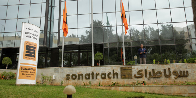 An employee stands near the headquarter of the state energy company Sonatrach in Algiers, Algeria june 26, 2016.Reuters/Ramzi Boudia