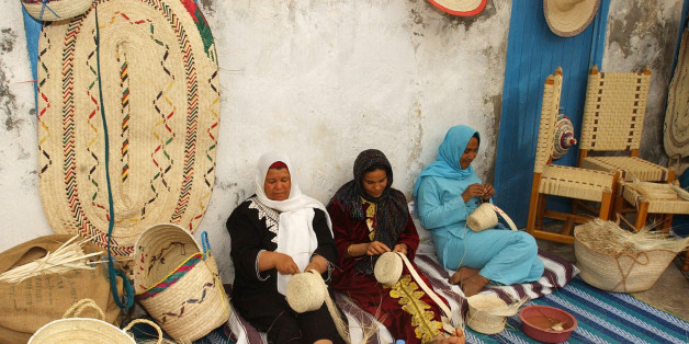**FILE** Women make baskets in Gabes, south of Tunis, in this May 2006 file photo. As Tunisia celebrates the 50th anniversary of a revolutionary law that gave women some of the same rights as men, many women's rights advocates warn that the 1956 text needs urgent updating, especially its section on inheritance law.(AP Photo/Hassene Dridi)