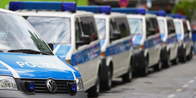 MUNICH, GERMANY - MAY 15:  A fleet of police or Polizei vans are pictured parked near the fans of Bayern Muenchen as they celebrate winning the German Championship title on the town hall square at Marienplatz on May 15, 2016 in Munich, Germany.  (Photo by Dean Mouhtaropoulos/Bongarts/Getty Images)