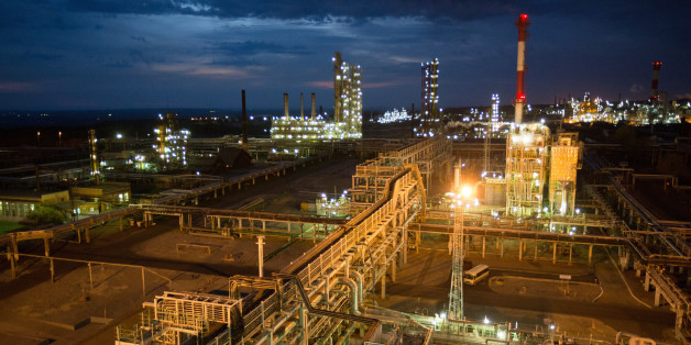 The sulphuric acid regeneration facility, right, sits illuminated by lights during evening operations at the Bashneft-Ufaneftekhim oil refinery, operated by Bashneft PAO, in Ufa, Russia, on Tuesday, Sept. 27, 2016. Bashneft distributes petroleum products and petrochemicals around the world and in Russia via filling stations. Photographer: Andrey Rudakov/Bloomberg via Getty Images