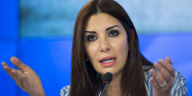 Franco-Syrian politician and leading figure of opposition to the Syrian government, Randa Kassis, gestures while speaking during a press conference in Moscow, Russia, Thursday, Nov. 19, 2015. (AP Photo/Alexander Zemlianichenko)