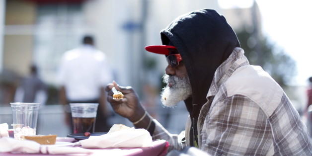 A man eats an early Thanksgiving meal served to the homeless at the Los Angeles Mission in Los Angeles, California, November 25, 2015.   REUTERS/Mario Anzuoni