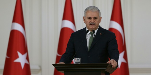 ANKARA, TURKEY - NOVEMBER 24 : Prime Minister of Turkey, Binali Yildirim addresses a speech to the teachers from 81 different cities of the country during a lunch, organized within the ceremonies, marking November 24 Teachers' Day, at Cankaya Palace in Ankara, Turkey on November 24, 2016. (Photo by Utku Ucrak/Anadolu Agency/Getty Images)