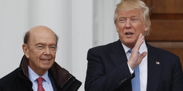 President-elect Donald Trump calls out to media as he greets investor Wilbur Ross at the Trump National Golf Club Bedminster clubhouse, Sunday, Nov. 20, 2016, in Bedminster, N.J.. (AP Photo/Carolyn Kaster)