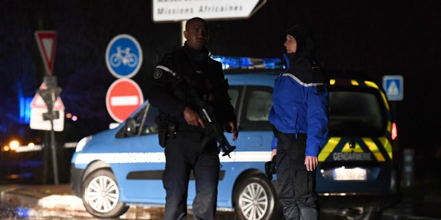 Gendarmes stand guard on a road near a retirement home for monks in Montferrier-sur-Lez, southern France, early on November 25, 2016, after an armed man burst in the home killing a woman with a knife.Armed police were hunting the man inside the home, which is home to around 70 men and women who have served as missionaries in Africa. Authorities said it was a 'criminal act'. / AFP / PASCAL GUYOT        (Photo credit should read PASCAL GUYOT/AFP/Getty Images)