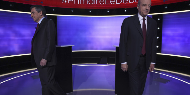 The two finalists for the right-wing Les Republicains (LR) party primaries ahead of the 2017 presidential election, Francois Fillon, left, and Alain Juppe, move after posing for photographs prior to taking part of a TV debate at French TV station TF1, in Boulogne-Billancourt, outside Paris Thursday Nov. 24, 2016. Former Prime Ministers Francois Fillon and Alain Juppe will meet in a runoff next Sunday for the nomination to be France's conservative candidate for president. (Eric Feferberg/ Pool Photo via AP)