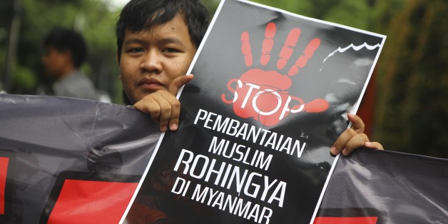 JAKARTA, INDONESIA - NOVEMBER 25 : An Indonesian Muslim activist carries a banner to protest violence and mass killings against Rohingya Muslims during a military crackdown in front of Myanmar Embaasy in Jakarta, Indonesia on November 25, 2016.   (Photo by Agoes Rudianto /Anadolu Agency/Getty Images)