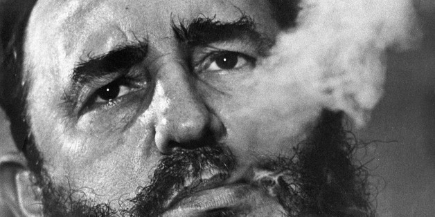 FILE - In this March 1985 file photo, Cuban Prime Minister Fidel Castro exhales cigar smoke during an interview at his presidential palace in Havana, Cuba. Castro, a Havana attorney who fought for the poor, overthrew dictator Fulgencio Batista's government on Jan. 1, 1959. As Castro turns 90 on Aug. 13, 2016, it's an uncertain time, with no settled consensus around his legacy. The government and its backers laud Castro's nationalism and his construction of a social safety net that prov