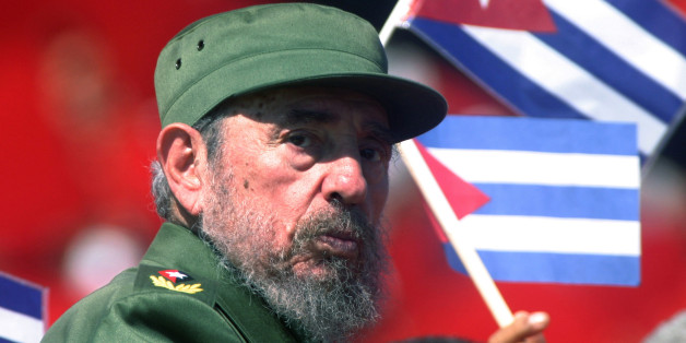 Then Cuban President Fidel Castro glances over his shoulder during the May Day commemoration at Revolution Square in Havana, in this May 1, 2004 file photo. Picture taken May 1, 2004. REUTERS/Rafael Perez/Files   (CUBA - Tags: POLITICS ANNIVERSARY OBITUARY)