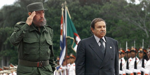 Cuban president Fidel Castro (L) and Abdelaziz Bouteflika (R), president of Algeria, salute troops in a ceremony 15 April 2000, in Havana, Cuba.  Bouteflika is making an official visit to Cuba after the culmination of the South Summit in which he participated. (ELECTRONIC IMAGE) AFP PHOTO/ Adalberto Roque        (Photo credit should read ADALBERTO ROQUE/AFP/Getty Images)