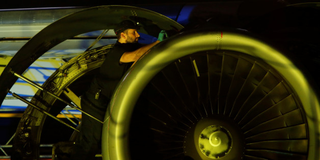 An aircraft technician carries out maintenance on the engine of an airplane inside a Lufthansa Technik hangar at Malta International Airport outside Valletta, Malta, November 23, 2016. REUTERS/Darrin Zammit Lupi  MALTA OUT. NO COMMERCIAL OR EDITORIAL SALES IN MALTA