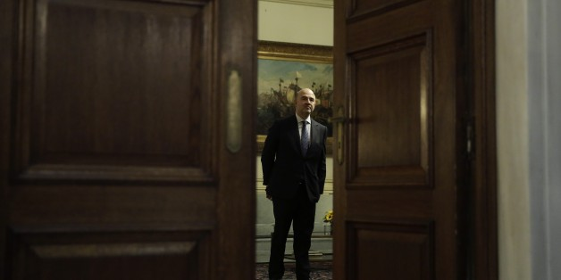 European Commissioner for Economic and Financial Affairs Pierre Moscovici stands before a meeting with the Greek Prime Minister in Athens, on Tuesday, Nov. 3, 2015. Moscovici's talks with officials in Greece's leftwing government will focus on the progress of reforms demanded by the country's European creditors in return for a third multi-billion euro bailout. (AP Photo/Petros Giannakouris)