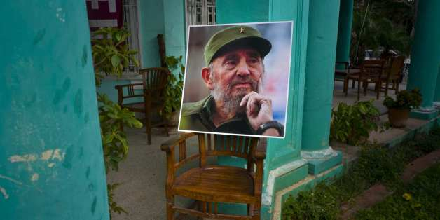 An image of the late Fidel Castro stands on a chair in a government building in Havana, Cuba, Sunday, Nov. 27, 2016, two days after his death. Cuba is observing nine days of mourning for the former president who ruled Cuba for half a century. (AP Photo/Ramon Espinosa)