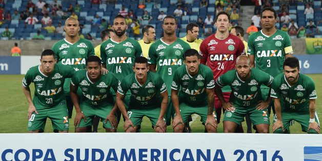 Players of Brazil's team Chapecoense pose for pictures during their 2016 Copa Sudamericana football match against Brazil's Cuiaba held at Arena Pantanal stadium, in Cuiaba, Brazil, on August 25, 2016. / AFP / NELSON ALMEIDA        (Photo credit should read NELSON ALMEIDA/AFP/Getty Images)