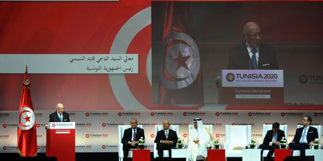 Tunisian President Beji Caid Essebsi (L) gives a speech during the opening ceremony of the 'Tunisia 2020' international investment conference on November 29, 2016 in Tunis.  France and Qatar promised billions of dollars of financial support to Tunisia at the launch Tuesday of a conference aimed at reviving the country's struggling economy. Nearly six years after its Arab Spring revolution, Tunisia is hosting the conference in a bid to face down daunting economic challenges. / AFP / FETHI BELAID        (Photo credit should read FETHI BELAID/AFP/Getty Images)