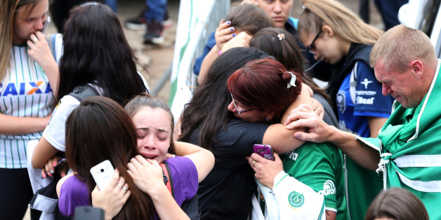 Fans of Chapecoense soccer team react in front of the Arena Conda stadium in Chapeco, Brazil, November 29, 2016. REUTERS/Paulo Whitaker