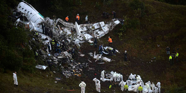 Rescuers search for survivors from the wreckage of the LAMIA airlines charter plane carrying members of the Chapecoense Real football team that crashed in the mountains of Cerro Gordo, municipality of La Union, on November 29, 2016.A charter plane carrying the Brazilian football team crashed in the mountains in Colombia late Monday, killing as many as 75 people, officials said.  / AFP / Raul ARBOLEDA        (Photo credit should read RAUL ARBOLEDA/AFP/Getty Images)