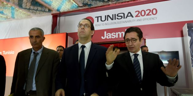Tunisian Prime Minister Youssef Chahed (C) and Tunisia's Investment and International Cooperation Minister Fadhel Abdelkefi (R) arrive to inspect the final preparation at the Congress Palace in the capital Tunis, on November 27, 2016, two days ahead of the opening ceremony of the 'Tunisia 2020' conference.