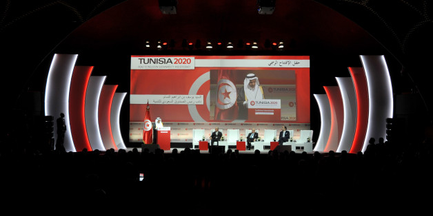 A general view of the opening ceremony of the 'Tunisia 2020' international investment conference on November 29, 2016 in Tunis.France and Qatar promised billions of dollars of financial support to Tunisia at the launch of the conference aimed at reviving the country's struggling economy. Nearly six years after its Arab Spring revolution, Tunisia is hosting the conference in a bid to face down daunting economic challenges. / AFP / FETHI BELAID        (Photo credit should read FETHI BELAID/AFP/Get