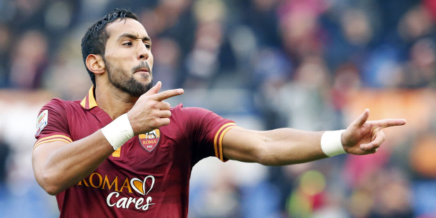 AS Roma's Mehdi Benatia celebrates after scoring against Genoa during their Serie A soccer match at Olympic stadium in Rome, January 12, 2014.  REUTERS/Stefano Rellandini  (ITALY - Tags: SPORT SOCCER)